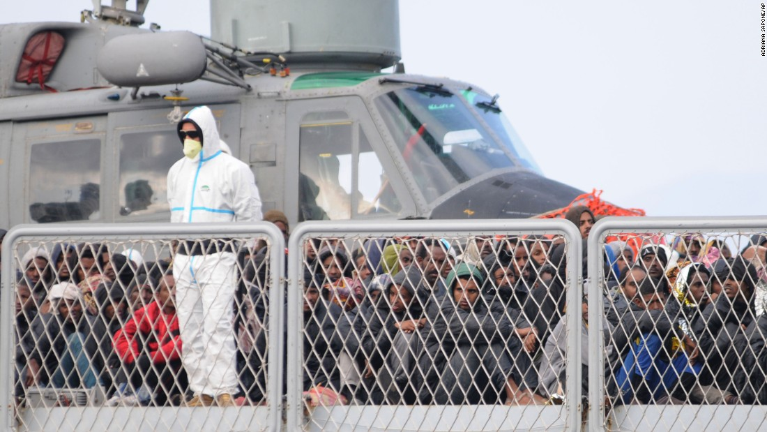 Rescued migrants wait to disembark from an Italian Navy vessel in the harbor of Reggio Calabria, Italy, on Tuesday, April 14. The European Union is expected to unveil a new strategy aimed at tackling the migrant wave in late May.