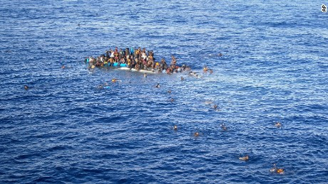 A picture made available on 20 April 2015 shows a boat with refugees close to the cargo ship 'OOC Jaguar' on the Mediterranean sea on 12 April 2015.