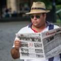 getty cuba man reading granma newspaper