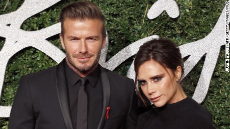 David Beckham and his wife Victoria pose regarding photos about the red carpet upon arrival to become able to show up at the actual British Style Awards 2014.