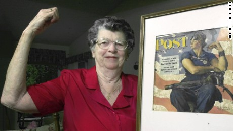 """In this May 22, 2002 file photo, Mary Doyle Keefe poses at her home in Nashua, N.H., with the May 29, 1943, cover of the Saturday Evening Post for which she had modeled as """"Rosie the Riveter"""" in a Norman Rockwell painting. Keefe died Tuesday, April 21, 2015, in Simsbury, Conn., after a brief illness. She was 92"""