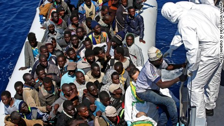"In this photo made available Thursday, April 23, 2015, migrants crowd and inflatable dinghy as rescue vassel "" Denaro "" of the Italian Coast Guard approaches them, off the Libyan coast, in the Mediterranean Sea, Wednesday, April 22, 2015.  European Union leaders gathering for an extraordinary summit are facing calls from all sides to take emergency action to save lives in the Mediterranean, where hundreds of migrants are missing and feared drowned in recent days. (Alessandro Di Meo/ANSA via AP Photo) ITALY OUT"