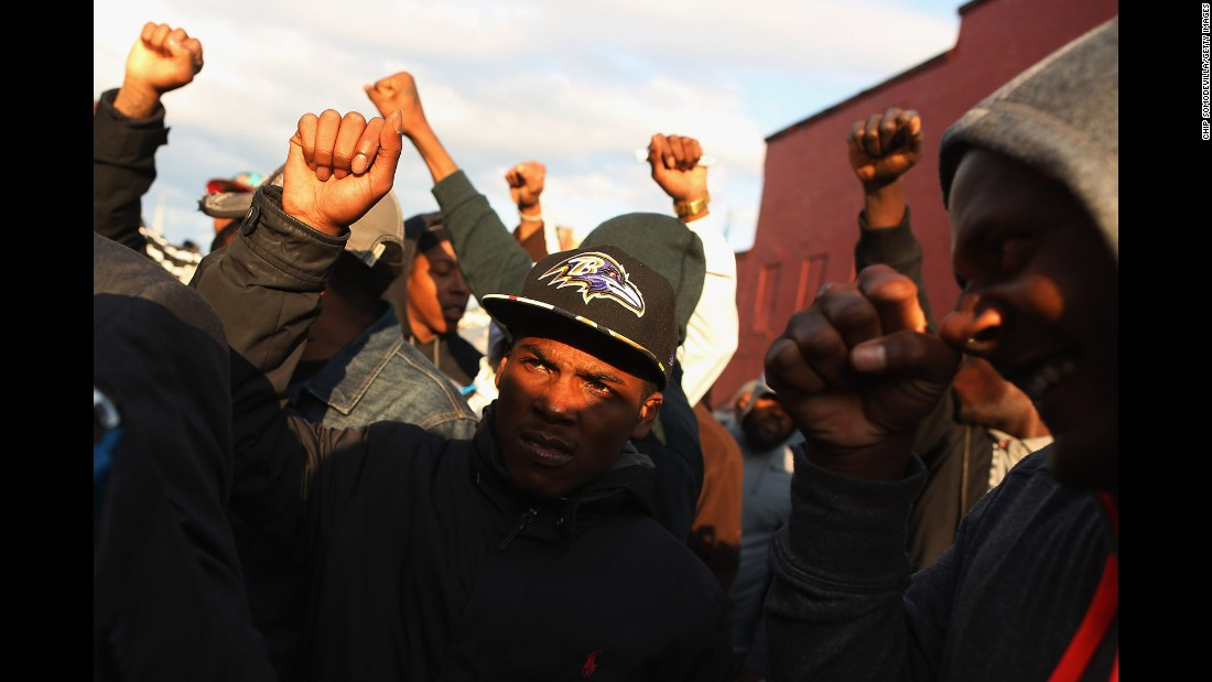 Demonstrators put their fists in the air during a protest outside the Baltimore police's Western District station on Wednesday, April 22.