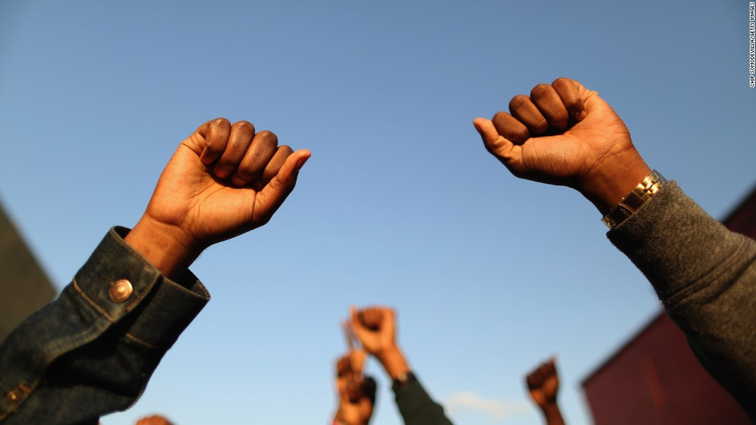 Demonstrators put their fists in the air during the protest on April 22.