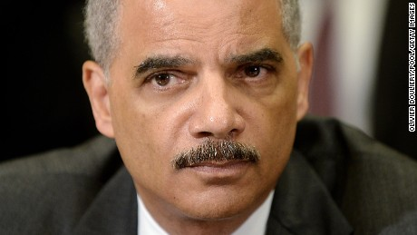 U.S. Attorney General Eric Holder attends a meeting with the My Brother's Keeper Task Force to receive a 90-day report on its progress in the Roosevelt Room of the White House in May 2014.