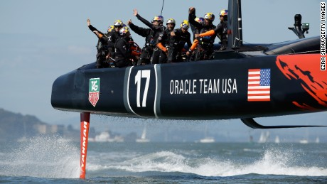 Caption:SAN FRANCISCO, CA - SEPTEMBER 22: Oracle Team USA skippered by James Spithill waves to the crowd after beating Emirates Team New Zealand in race 15 of the America's Cup Finals on September 22, 2013 in San Francisco, California. Oracle Team USA won both race 14 and 15 today. (Photo by Ezra Shaw/Getty Images)