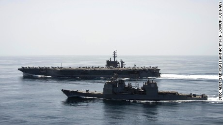 50421-N-ZF498-231 ARABIAN SEA (April 21, 2015) The aircraft carrier USS Theodore Roosevelt (CVN 71) and the guided-missile cruiser USS Normandy (CG 60) operate in the Arabian Sea conducting maritime security operations. (U.S. Navy photo by Mass Communication Specialist 3rd Class Anthony N. Hilkowski/Released)