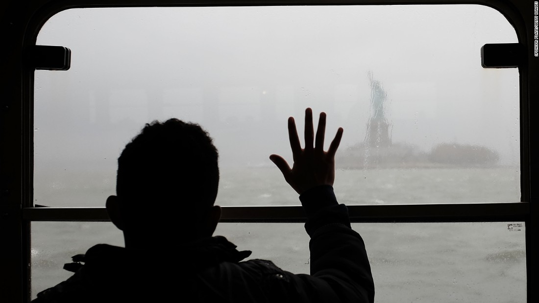 A man looks out at the Statue of Liberty in the rain and fog from the Staten Island Ferry on April 20 in New York City. On June 17, 1885, the Statue of Liberty arrived in New York in 350 pieces.