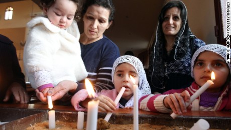 Assyrian Christian women and their daughters, who had fled the unrest in Syria, attend a prayer for the 220 Assyrian Christians abducted by Islamic State group jihadists from villages in northeastern Syria in recent days, at the Saint Georges Assyrian Church in Jdeideh, northeast of the Lebanese capital Beirut on February 26, 2015.