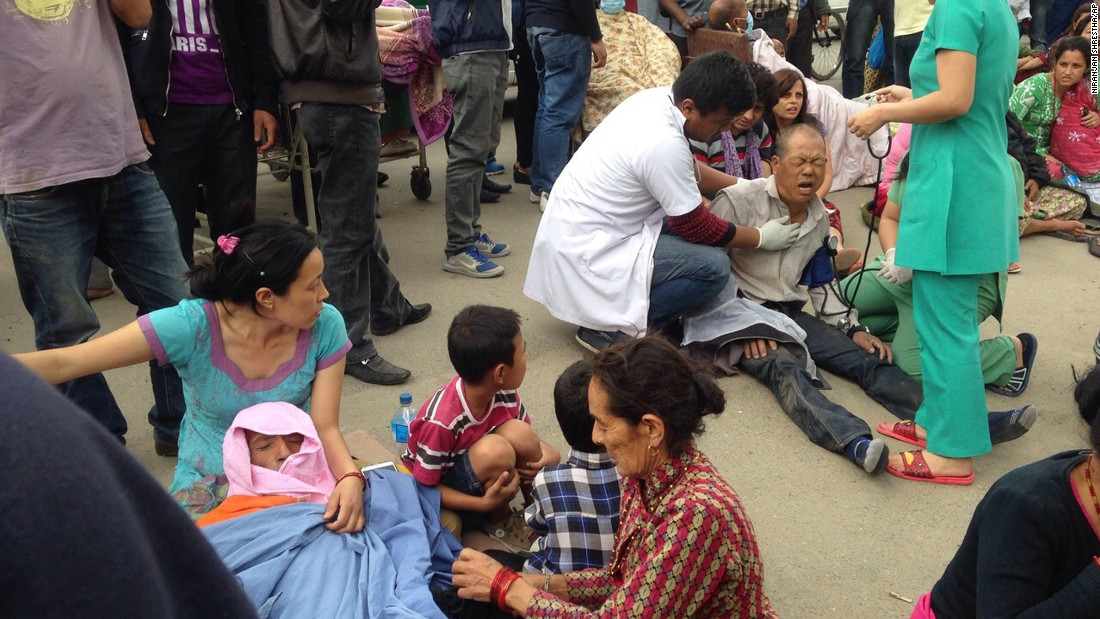 Injured people are treated outside a hospital in Kathmandu.