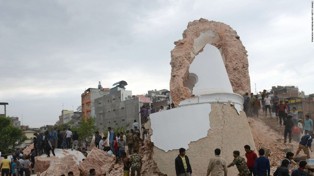 Nepalese rescue workers gather at the ruins of Dharahara.
