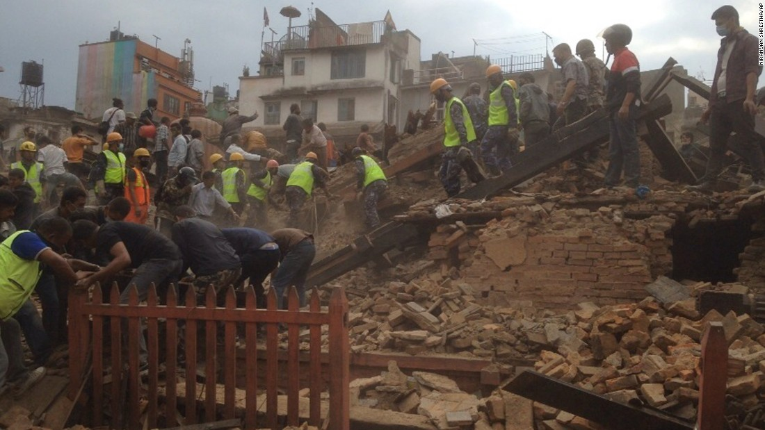 Rescuers remove debris at Basantapur Durbar Square while looking for survivors of the massive quake.