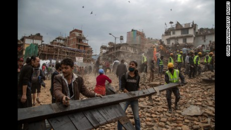Rescue workers clear debris in Basantapur Durbar Square in Kathmandu while searching for survivors.