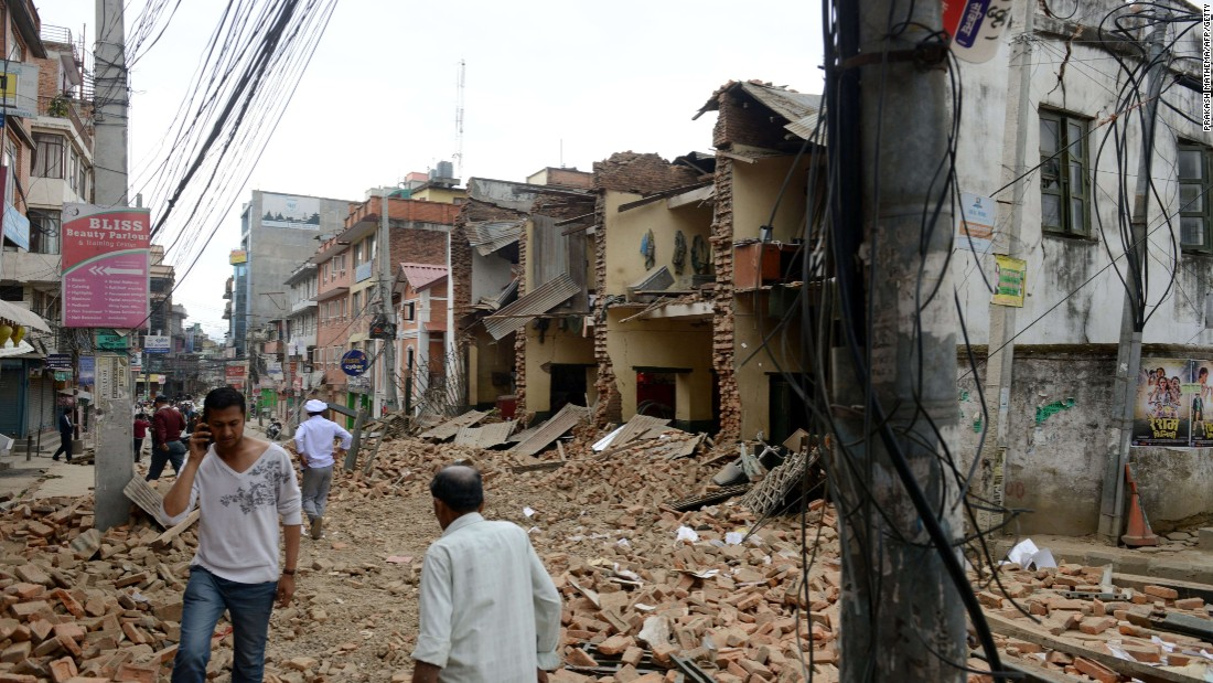The rubble of collapsed walls fills a street in Lalitpur, on the outskirts of Kathmandu, on April 25.