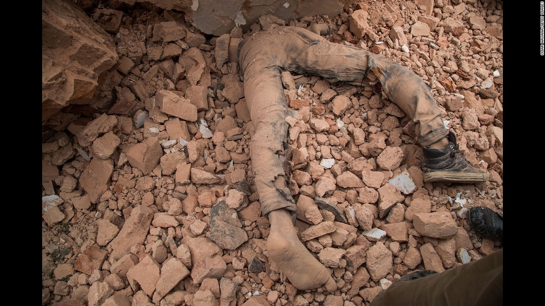 A victim of Nepal's earthquake lies in the debris of Dharahara after it collapsed on April 25 in Kathmandu, Nepal.