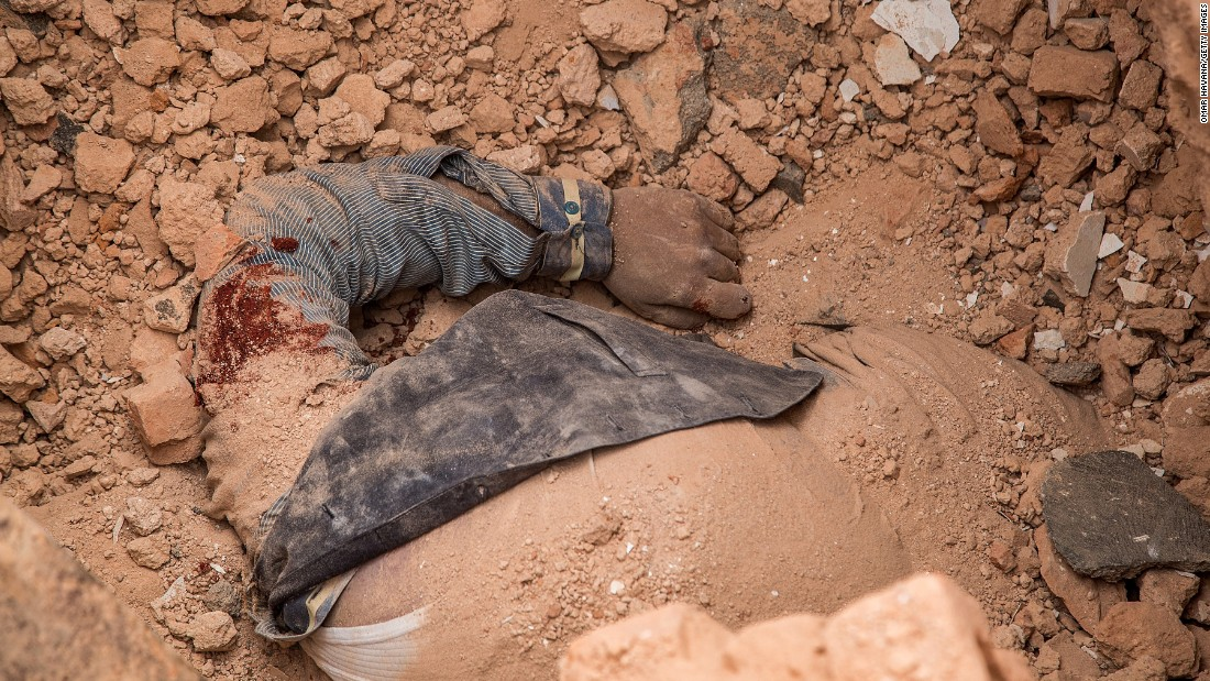 A victim's body is seen in the debris of the collapsed Dharahara on April 25.