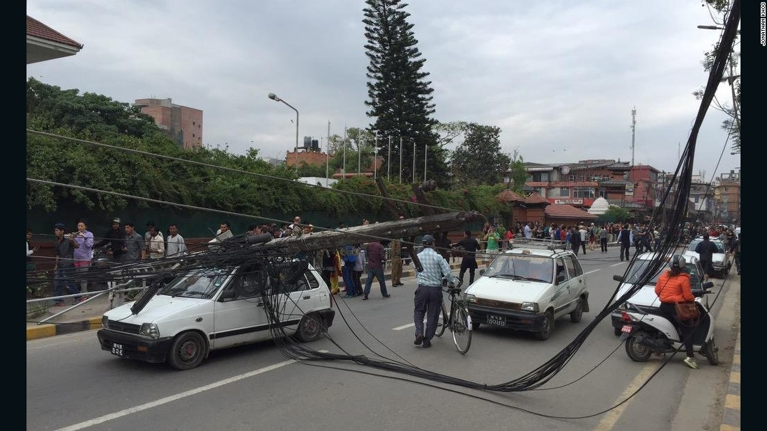 Jonathan Khoo's photo shows downed power lines and people gathering in the street.