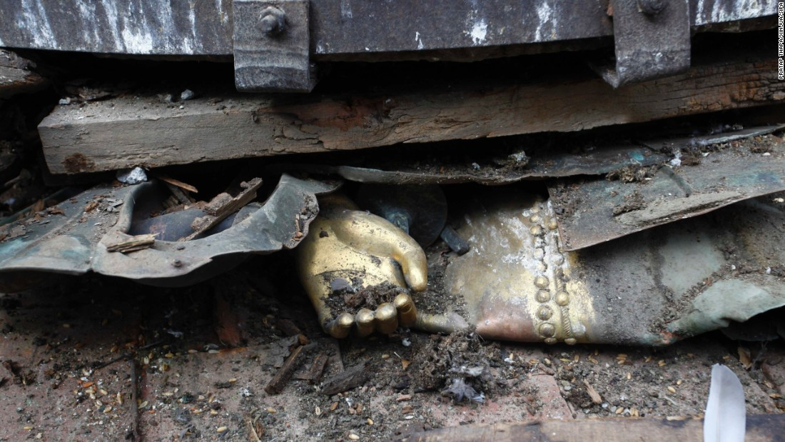 The hand of a statue is seen under debris in Basantapur Durbar Square in Kathmandu.