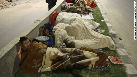 People sleep outside on a street a in Kathmandu, Nepal, on Saturday, April 25.