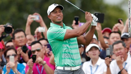Tiger Woods of the United States hits a shot during his match against Rory McIlroy of Northern Ireland at Blackstone Course Mission Hills on October 28, 2013 in Haikou, China. (Photo by Lintao Zhang/Getty Images)