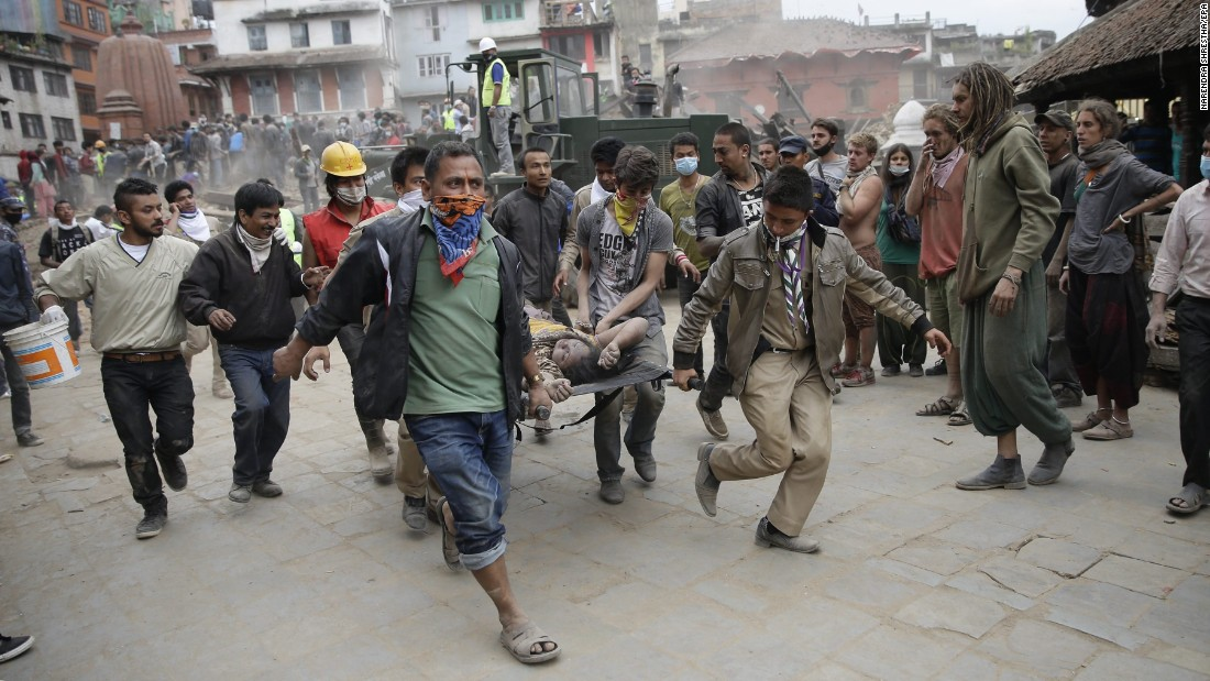 Civilian rescuers carry a person on a stretcher in Kathmandu, Nepal, on April 25.