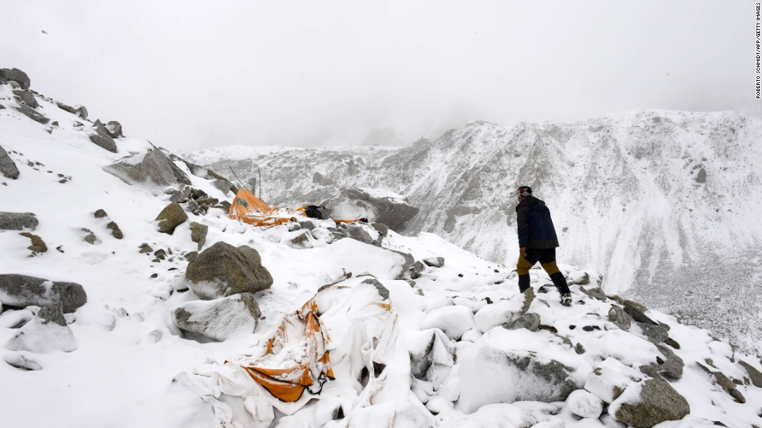 Expedition guide Pasang Sherpa runs toward flattened tents on April 25 in search of survivors, shortly after an avalanche that flattened parts of Everest base camp.