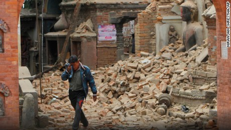 A Nepalese man cries as he walks through the earthquake debris in Bhaktapur, near Kathmandu, Nepal, Sunday, April 26, 2015. A strong magnitude 7.8 earthquake shook Nepal's capital and the densely populated Kathmandu Valley before noon Saturday, causing extensive damage with toppled walls and collapsed buildings, officials said. (AP Photo/Niranjan Shrestha) Use Informatio