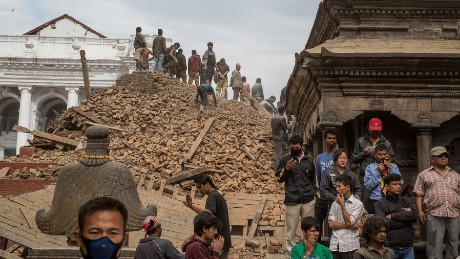 KATHMANDU, NEPAL - APRIL 25: Emergency workers and bystanders clear debris while searching for survivors under a collapsed temple in Basantapur Durbar Square following an earthquake on April 25, 2015 in Kathmandu, Nepal. A major 7.8 earthquake hit Kathmandu mid-day on Saturday, and was followed by multiple aftershocks that triggered avalanches on Mt. Everest that buried mountain climbers in their base camps. Many houses, buildings and temples in the capital were destroyed during the earthquake, leaving hundreds dead or trapped under the debris as emergency rescue workers attempt to clear debris and find survivors. (Photo by Omar Havana/Getty Images)