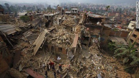 Rescue workers remove debris on April 26 as they search for victims in Bhaktapur, Nepal.