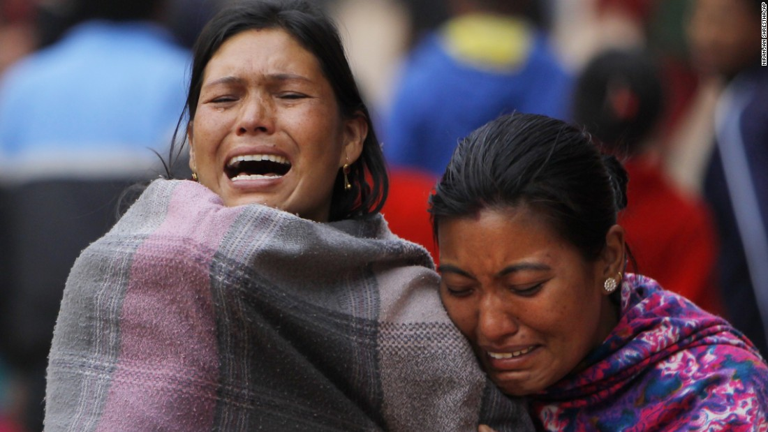 Family members break down on April 26 during the cremation of a loved one killed in the earthquake in Bhaktapur.