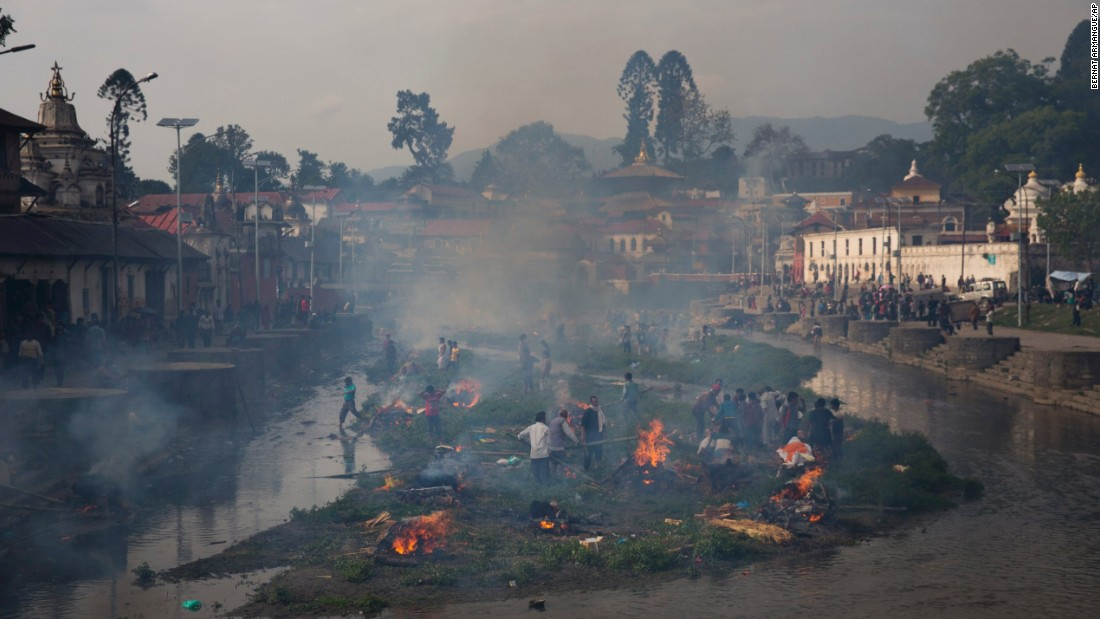 Smoke from funeral pyres fills the air at the Pashupatinath temple on the banks of Bagmati River in Kathmandu, Nepal, on April 26.