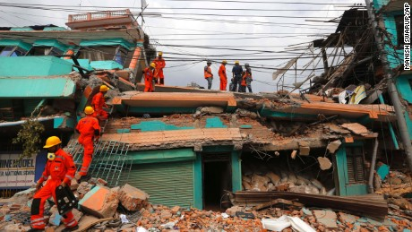 Members of India's National Disaster Response Force look for survivors  in Kathmandu, Nepal, on April 26.
