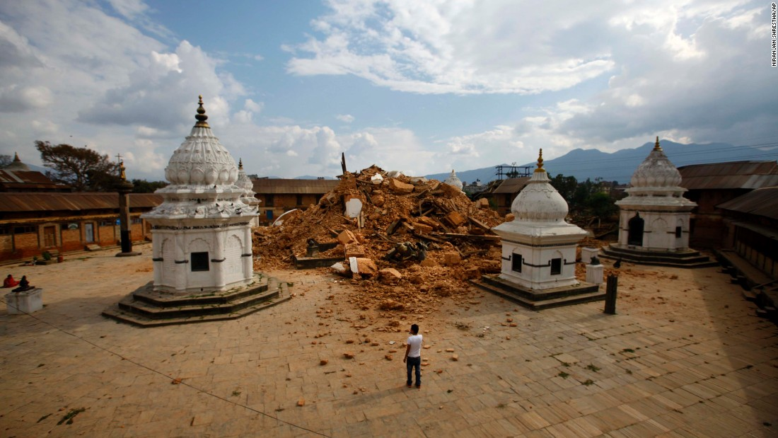 People look at the debris of one of the oldest temples in Kathmandu on April 26, after it suffered damage from the earthquake.