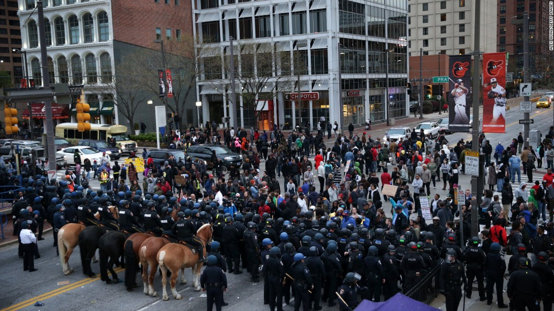 Protesters stand off with police during a march in honor of Gray in Baltimore on Saturday, April 25.