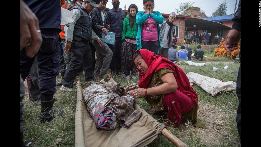 A woman cries on April 26 while identifying the body of a relative in Bhaktapur.
