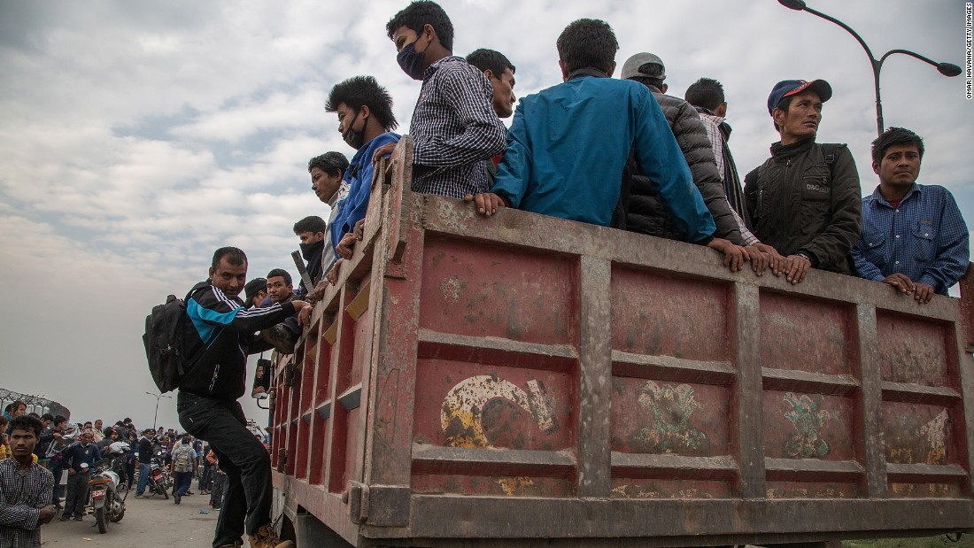 Residents are evacuated via truck from Kathmandu, Nepal, on April 26.