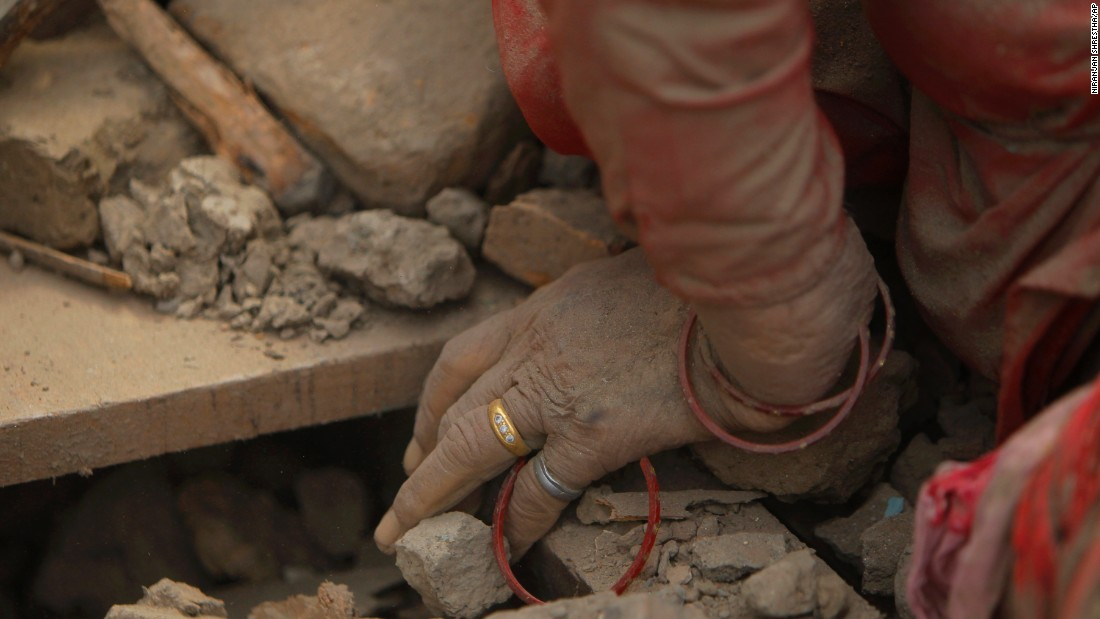The hand of a dead woman is seen as rescuers search through debris in Bhaktapur on April 26.