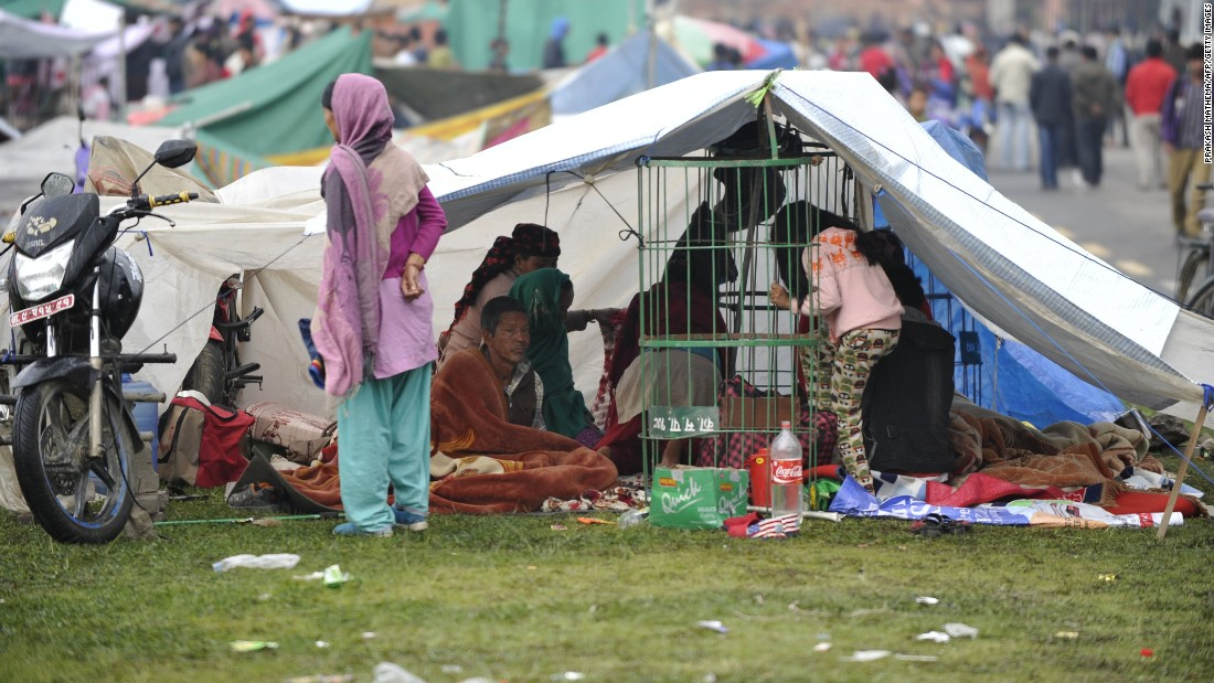 Nepalese people rest in a temporary shelters of an Army ground in Kathmandu on April 27, two days after a 7.8 magnitude earthquake hit Nepal.