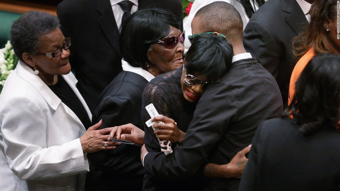 Gray's twin sister, Fredericka Gray, is embraced by family members and supporters during her brother's funeral.