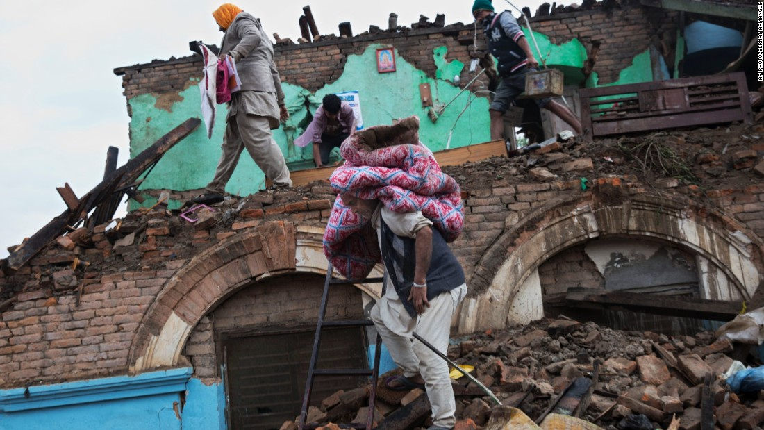 Residents rescue items from the debris of houses that were damaged in Saturday's earthquake in Kathmandu, Nepal on April 27.