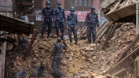 Rescue team members search for bodies in the debris of a collapsed temple at Basantapur Durbar Square on April 27, 2015 in Kathmandu, Nepal.