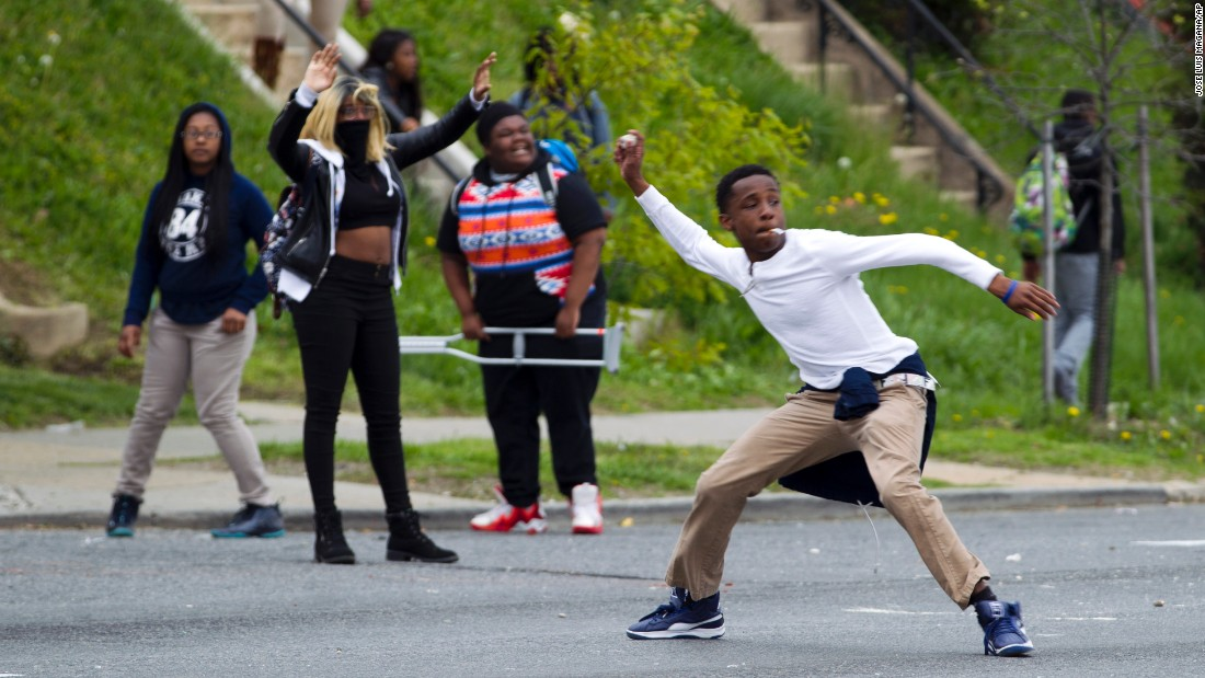 Demonstrators throw rocks at the police after Gray's funeral on April 27.
