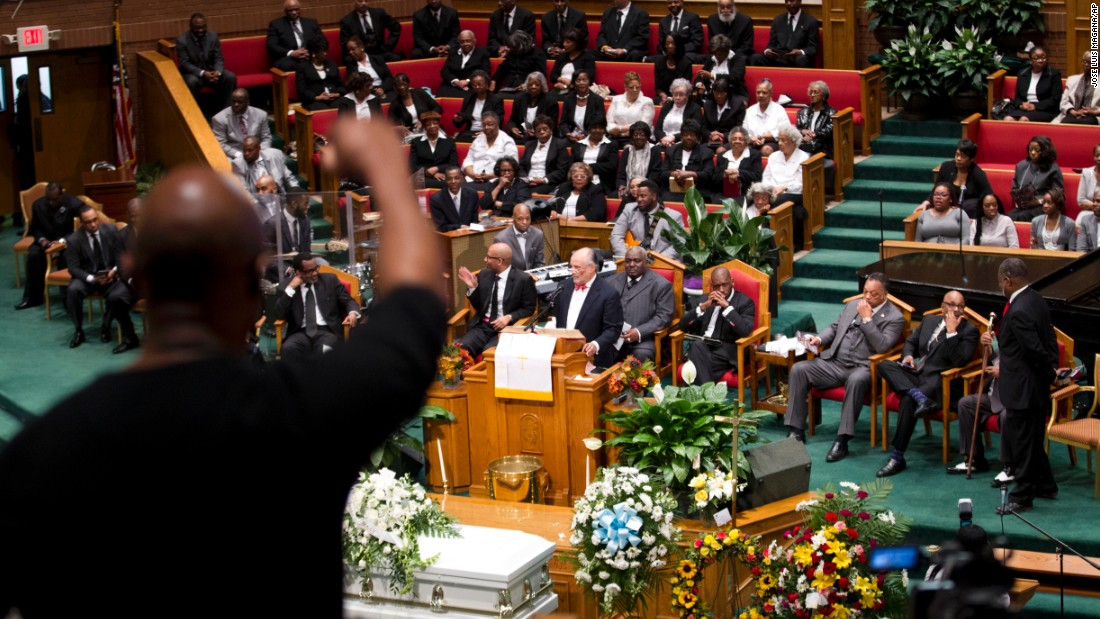 People in the audience react as attorney William Murphy speaks at Gray's funeral.