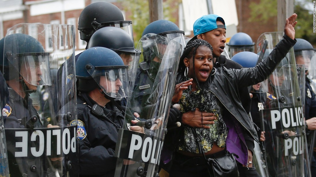 """Baltimore Police Department officers in riot gear push back protesters after the <a href=""""http://www.cnn.com/2015/04/27/us/gallery/freddie-gray-funeral/index.html"""">funeral of Freddie Gray</a> in Baltimore on Monday, April 27, 2015. Gray died on April 19 from a severe spinal cord injury that he allegedly suffered while in police custody a week earlier. His death has sparked ongoing protests in Baltimore and raised long-simmering tensions between police and residents there. Click through the gallery for more images:"""