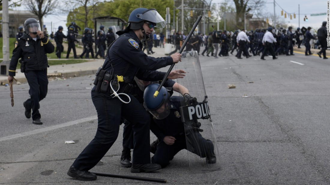 Police officers clash with protesters in the streets near Mondawmin Mall on April 27.