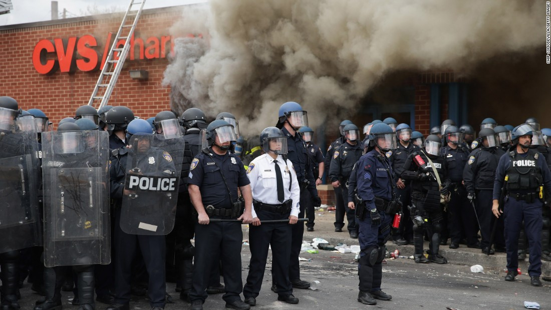 Baltimore Police form a perimeter around a CVS pharmacy that was looted and burned near the corner of Pennsylvania and North avenues during violent protests on April 27.