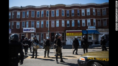 Maryland state troopers stand guard in Baltimore on Tuesday, April 28.