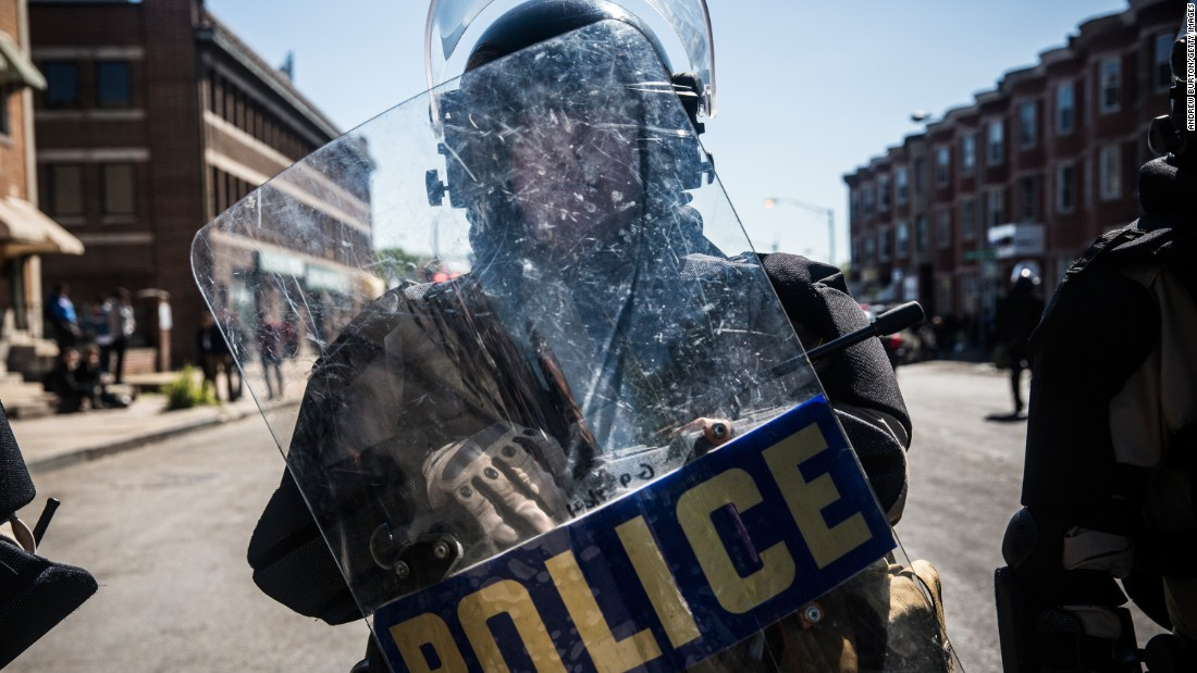 "Maryland State Police troopers stand guard in Baltimore on Tuesday, April 28. Riots broke out after <a href=""http://www.cnn.com/2015/04/27/us/gallery/freddie-gray-funeral/index.html"">the funeral for Freddie Gray</a>, who died of a severe spinal cord injury while in police custody. There were nearly 200 arrests, 144 vehicle fires and 15 structure fires in Baltimore during the unrest that began Monday, April 27, a city official said."