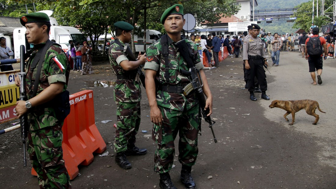 Indonesian soldiers and police officers stand guard at the Wijayapura ferry port in Cilacap on April 28.