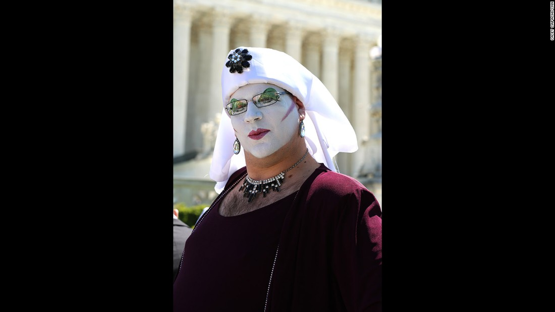 "Senior Novice Sister Sedusa Poly Tishun shows off her face paint outside the Supreme Court. ""We're here raising up our voices and our glitter in shouts of joy in support of marriage equality,"" Tishun said."